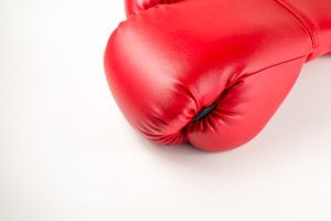 red leather boxing gloves on white isolated background